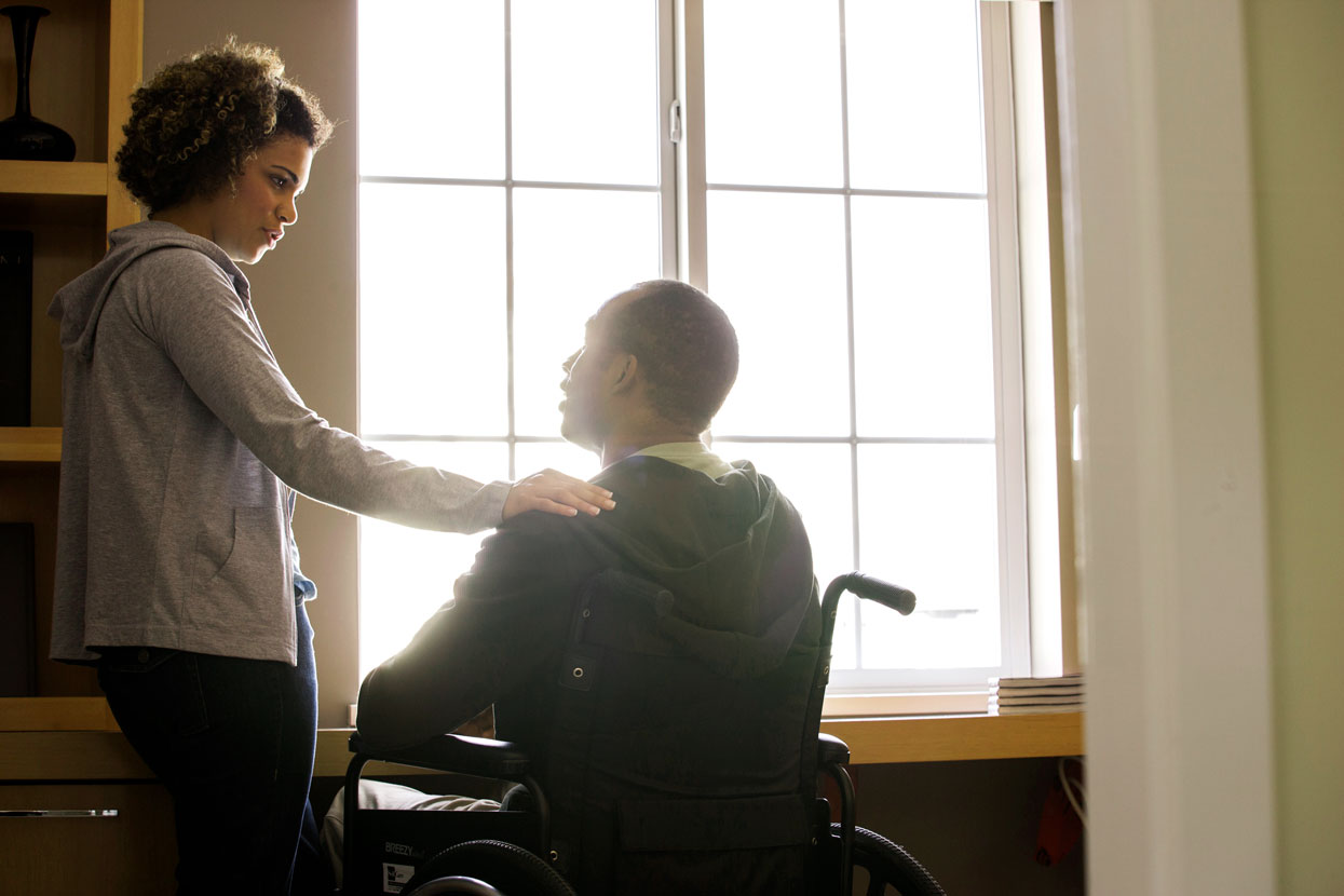 Woman with man in wheel chair